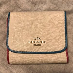 Multi-colored leather Coach Wallet.